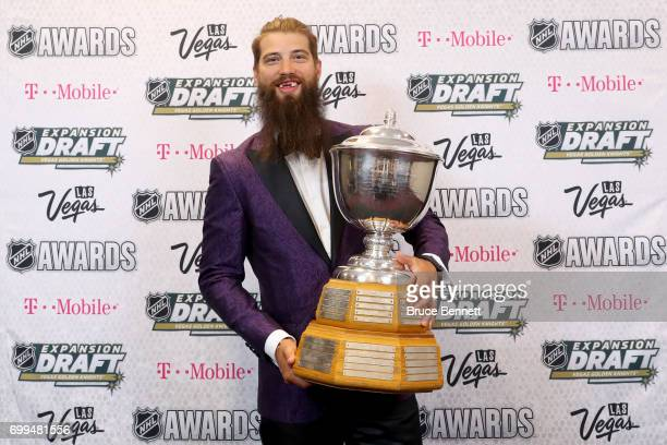 Brent Burns of the San Jose Sharks poses after winning the James Norris Memorial Trophy during the 2017 NHL Awards and Expansion Draft at TMobile...