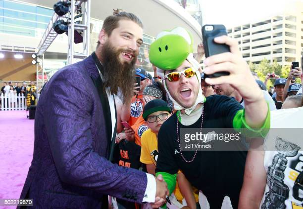 Brent Burns of the San Jose Sharks poses for a selfie photo as he arrives on the magenta carpet for the 2017 NHL Awards at TMobile Arena on June 21...