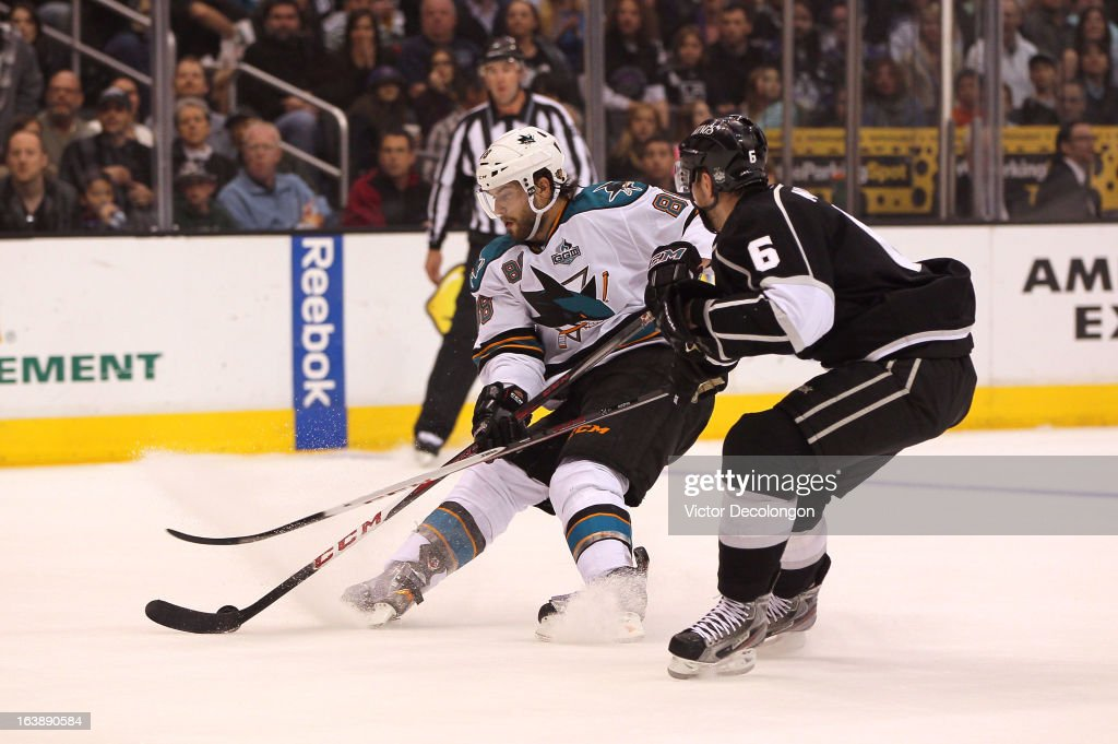 <a gi-track='captionPersonalityLinkClicked' href=/galleries/search?phrase=Brent+Burns&family=editorial&specificpeople=212883 ng-click='$event.stopPropagation()'>Brent Burns</a> #88 of the San Jose Sharks protects the puck from Jake Muzzin #6 of the Los Angeles Kings during the NHL game at Staples Center on March 16, 2013 in Los Angeles, California. The Kings defeated the Sharks 5-2.