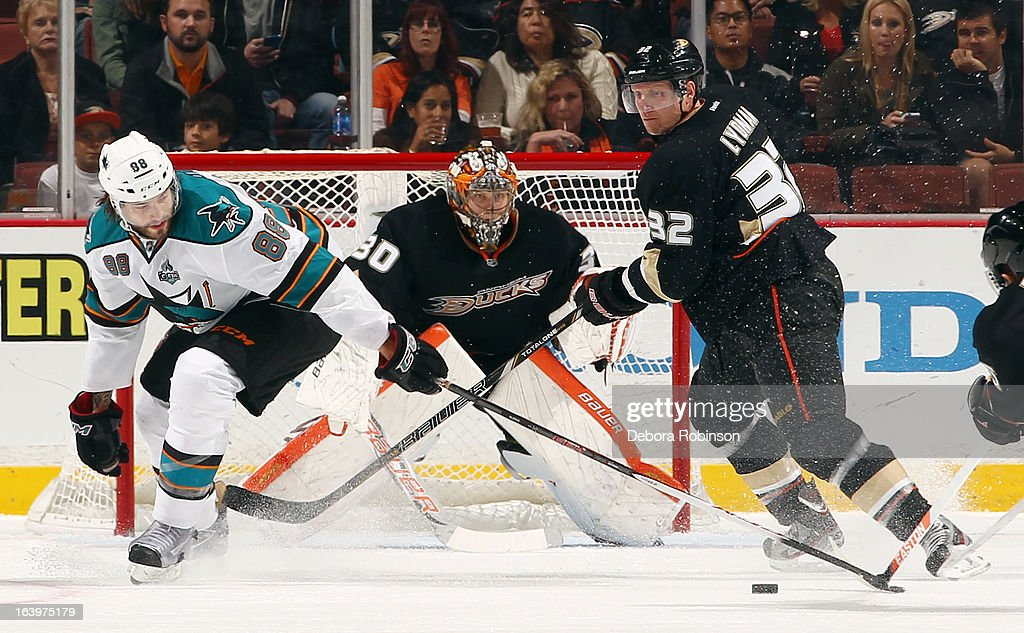 <a gi-track='captionPersonalityLinkClicked' href=/galleries/search?phrase=Brent+Burns&family=editorial&specificpeople=212883 ng-click='$event.stopPropagation()'>Brent Burns</a> #88 of the San Jose Sharks reaches for the puck in front of <a gi-track='captionPersonalityLinkClicked' href=/galleries/search?phrase=Toni+Lydman&family=editorial&specificpeople=204145 ng-click='$event.stopPropagation()'>Toni Lydman</a> #32 and <a gi-track='captionPersonalityLinkClicked' href=/galleries/search?phrase=Viktor+Fasth&family=editorial&specificpeople=7640136 ng-click='$event.stopPropagation()'>Viktor Fasth</a> #30 of the Anaheim Ducks on March 18, 2013 at Honda Center in Anaheim, California.