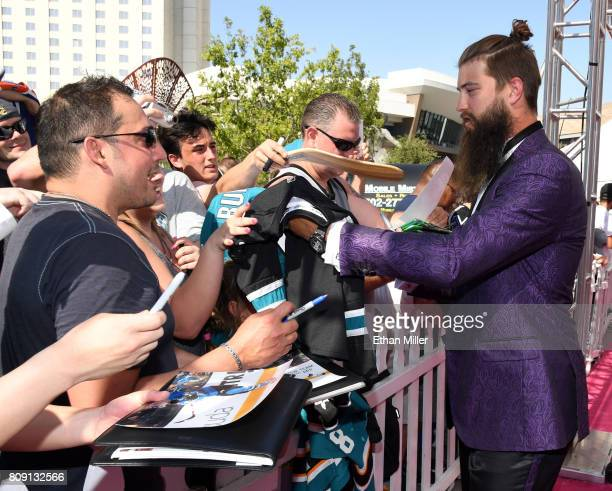 Brent Burns of the San Jose Sharks signs autographs for fans as he attends the 2017 NHL Awards at TMobile Arena on June 21 2017 in Las Vegas Nevada