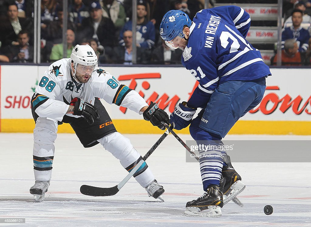 <a gi-track='captionPersonalityLinkClicked' href=/galleries/search?phrase=Brent+Burns&family=editorial&specificpeople=212883 ng-click='$event.stopPropagation()'>Brent Burns</a> #88 of the San Jose Sharks skates against James van Riemsdyk #21 of the Toronto Maple Leafs during an NHL game at the Air Canada Centre on December 3, 2013 in Toronto, Ontario, Canada. The Sharks defeated the Leafs 4-2.