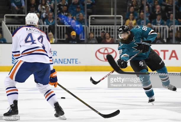 Brent Burns of the San Jose Sharks skates passes the puck by Zack Kassian of the Edmonton Oilers during the second period in Game Three of the...