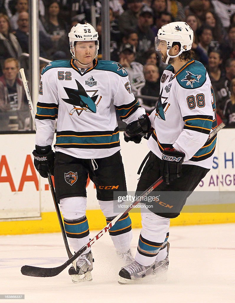 <a gi-track='captionPersonalityLinkClicked' href=/galleries/search?phrase=Brent+Burns&family=editorial&specificpeople=212883 ng-click='$event.stopPropagation()'>Brent Burns</a> #88 of the San Jose Sharks skates to teammate Matt Irwin #52 after Irwin's late third period power-play goal against the Los Angeles Kings during the NHL game at Staples Center on March 16, 2013 in Los Angeles, California. The Kings defeated the Sharks 5-2.