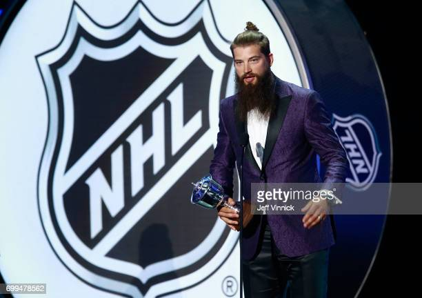 Brent Burns of the San Jose Sharks speaks onstage after receiving the James Norris Memorial Trophy during the 2017 NHL Awards Expansion Draft at...