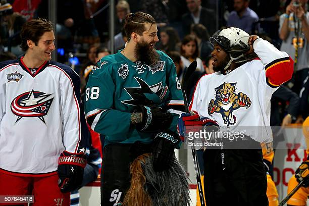 Brent Burns of the San Jose Sharks talks with PK Subban of the Montreal Canadiens as Brandon Saad of the Columbus Blue Jackets looks on in the...
