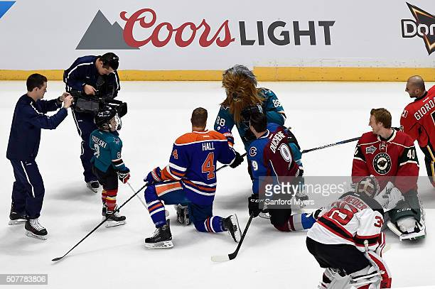 Brent Burns of the San Jose Sharks talks with Taylor Hall of the Edmonton Oilers in the Honda NHL Breakaway Challenge during the 2016 Honda NHL...