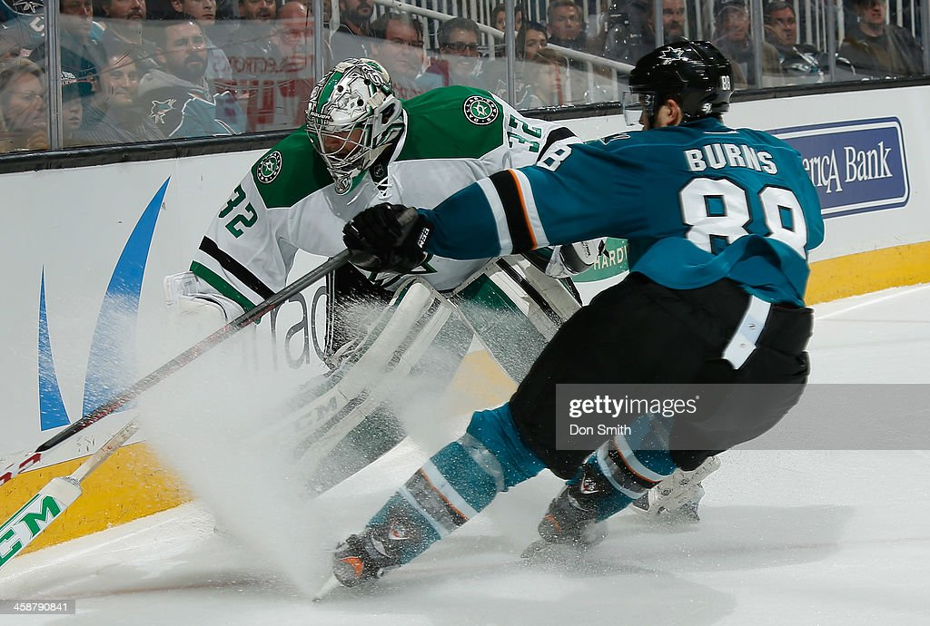 Brent Burns #88 of the San Jose Sharks tries to skate into the net against Kari Lehtonen #32 of the Dallas Stars during an NHL game on December 21, 2013 at SAP Center in San Jose, California.