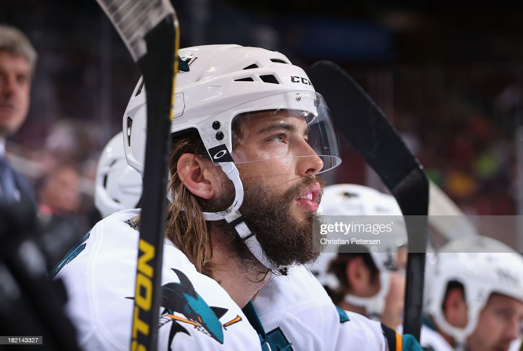 Brent Burns #88 of the San Jose Sharks watches from the bench during the preseason NHL game against the Phoenix Coyotes at Jobing.com Arena on September 27, 2013 in Glendale, Arizona. The Coyotes defeated the Sharks 2-1.