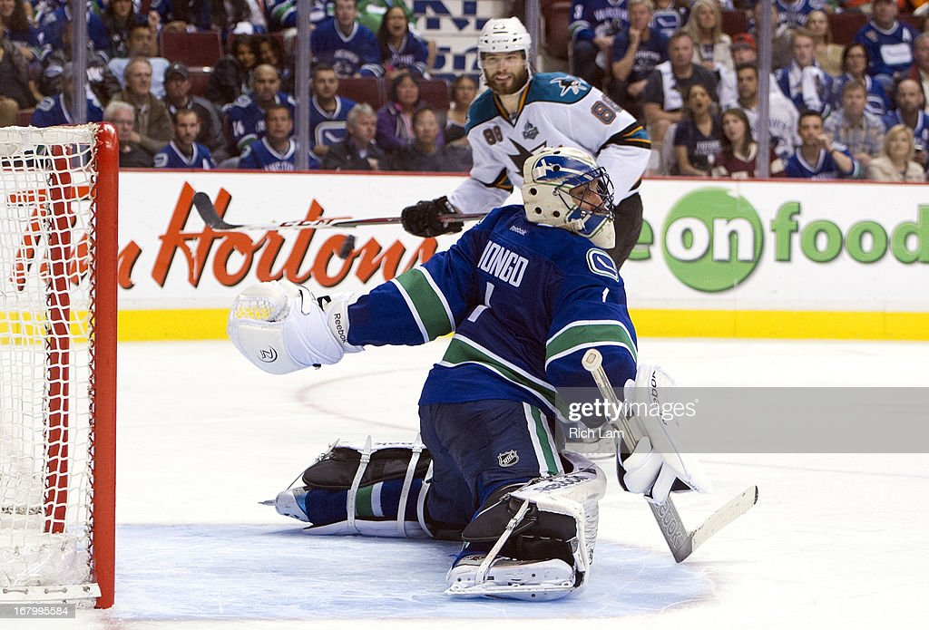 <a gi-track='captionPersonalityLinkClicked' href=/galleries/search?phrase=Brent+Burns&family=editorial&specificpeople=212883 ng-click='$event.stopPropagation()'>Brent Burns</a> #88 of the San Jose Sharks watches the puck shot by Raffi Torres (not pictured) of the San Jose Sharks sail past <a gi-track='captionPersonalityLinkClicked' href=/galleries/search?phrase=Roberto+Luongo&family=editorial&specificpeople=202638 ng-click='$event.stopPropagation()'>Roberto Luongo</a> #1 of the Vancouver Canucks during the overtime period in Game Two of the Western Conference Quarterfinals of the 2013 NHL Stanley Cup Playoffs, May 03, 2013 at Rogers Arena in Vancouver, British Columbia, Canada.