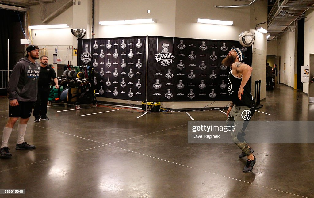 <a gi-track='captionPersonalityLinkClicked' href=/galleries/search?phrase=Brent+Burns&family=editorial&specificpeople=212883 ng-click='$event.stopPropagation()'>Brent Burns</a> #88, right, and <a gi-track='captionPersonalityLinkClicked' href=/galleries/search?phrase=Melker+Karlsson&family=editorial&specificpeople=13601327 ng-click='$event.stopPropagation()'>Melker Karlsson</a> #68 of the San Jose Sharks volley a soccer ball in the arena hallway to warm up prior to Game One of the 2016 NHL Stanley Cup Final against the Pittsburgh Penguins at Consol Energy Center on May 30, 2016 in Pittsburgh, Pennsylvania.