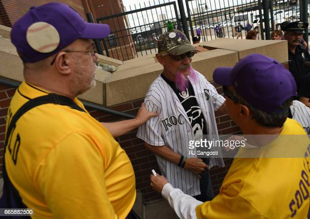 Brent Doeden aka 'Captain Earthman' center is welcomed by old friends as he arrives to Coors Field for the Colorado Rockies' home opener Coors Field...