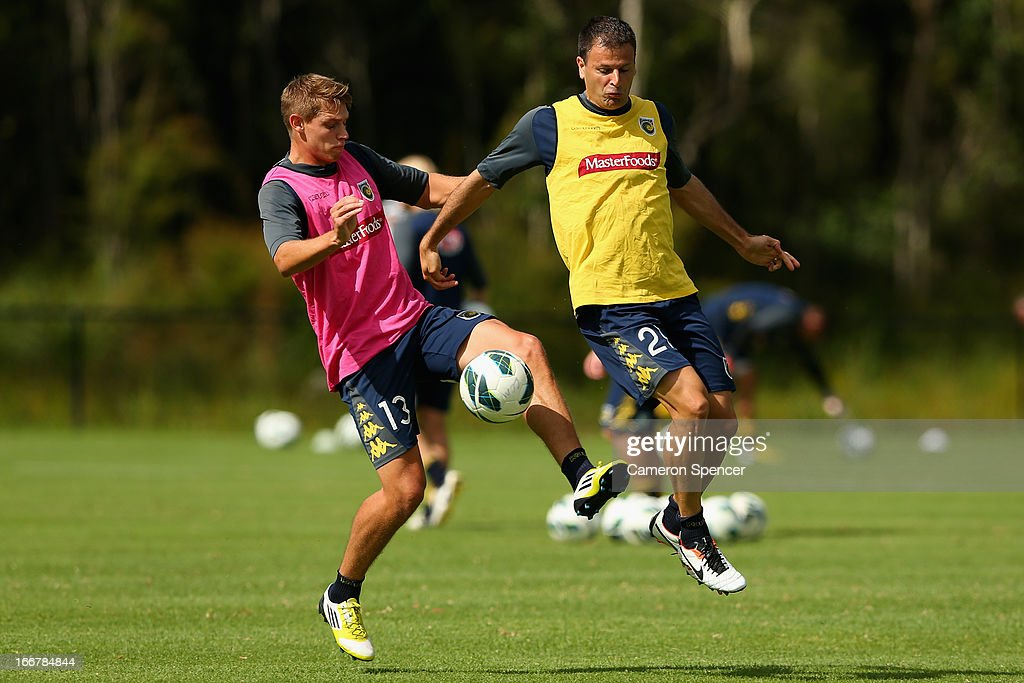 Brent Griffiths and <a gi-track='captionPersonalityLinkClicked' href=/galleries/search?phrase=Mile+Sterjovski&family=editorial&specificpeople=226701 ng-click='$event.stopPropagation()'>Mile Sterjovski</a> of the Mariners contest the ball during a Central Coast Mariners A-League training session at Central Coast Mariners Centre of Excellence on April 17, 2013 in Tuggerah, Australia.