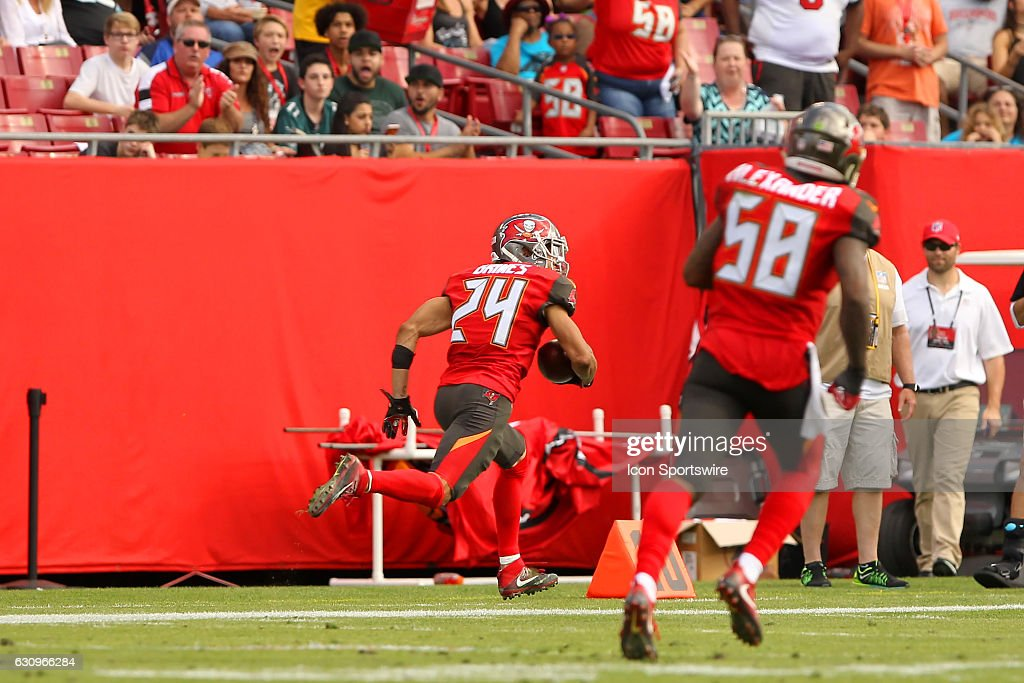 Brent Grimes (24) of the Buccaneers intercepts a pass and returns it for a touchdown during the NFL Game between the Carolina Panthers and Tampa Bay Buccaneers on January 01, 2017, at Raymond James Stadium in Tampa, FL.