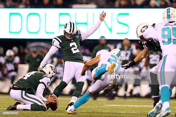 Brent Grimes of the Miami Dolphins attempts to block a field goal kicked by Nick Folk of the New York Jets during their game at MetLife Stadium on...