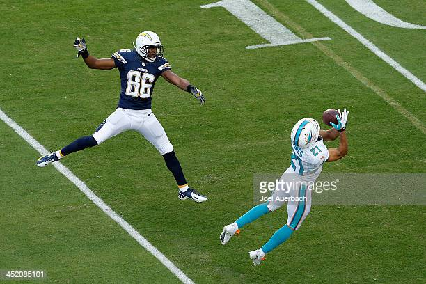 Brent Grimes of the Miami Dolphins intercepts the ball intended for Vincent Brown of the San Diego Chargers on November 17 2013 at Sun Life Stadium...