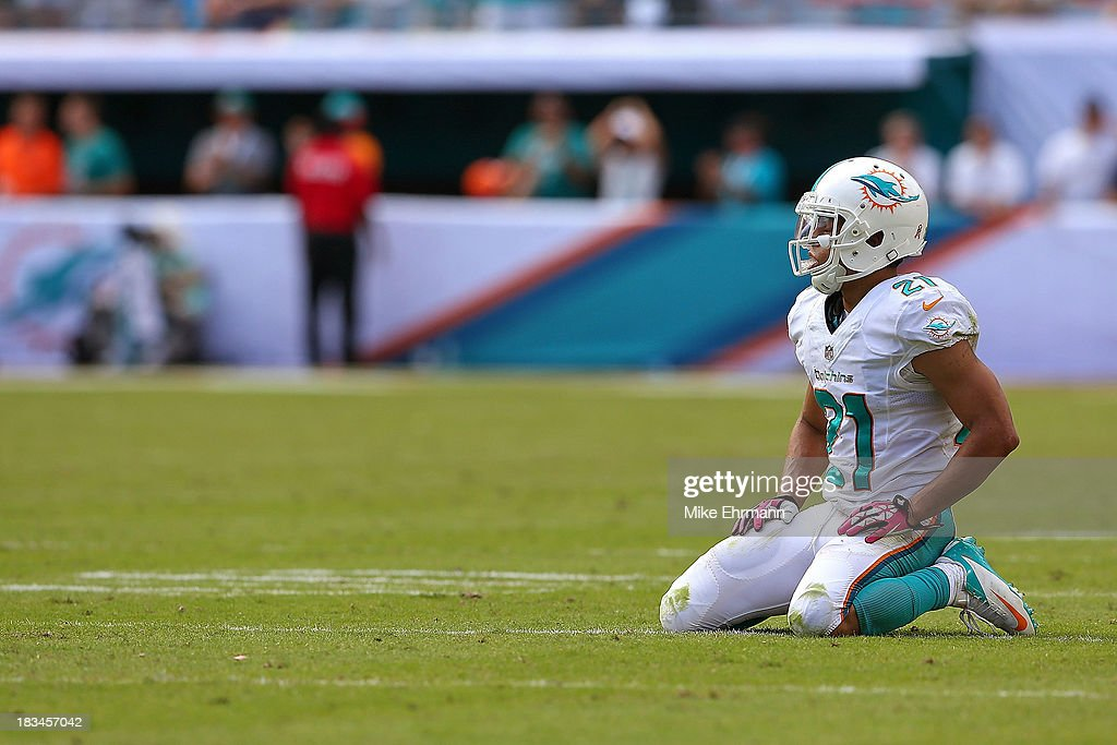 <a gi-track='captionPersonalityLinkClicked' href=/galleries/search?phrase=Brent+Grimes&family=editorial&specificpeople=4253995 ng-click='$event.stopPropagation()'>Brent Grimes</a> #21 of the Miami Dolphins reacts to a play during a game against the Baltimore Ravens at Sun Life Stadium on October 6, 2013 in Miami Gardens, Florida.