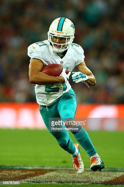 Brent Grimes of the Miami Dolphins rueshes during the NFL match between the Oakland Raiders and the Miami Dolphins at Wembley Stadium on September 28...