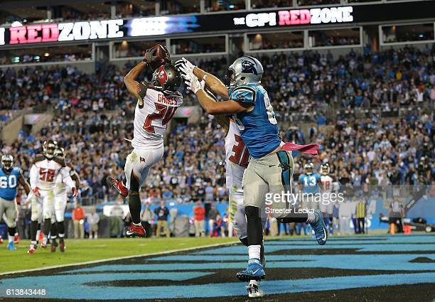 Brent Grimes of the Tampa Bay Buccaneers intercepts a pass intended for Greg Olsen of the Carolina Panthers late in the fourth quarter during their...