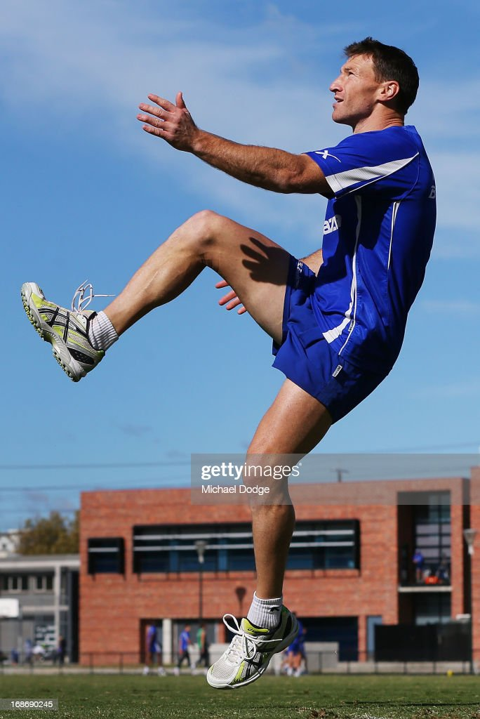 <a gi-track='captionPersonalityLinkClicked' href=/galleries/search?phrase=Brent+Harvey&family=editorial&specificpeople=214661 ng-click='$event.stopPropagation()'>Brent Harvey</a> kicks the ball during a North Melbourne Kangaroos AFL training session at Aegis Park on May 14, 2013 in Melbourne, Australia.
