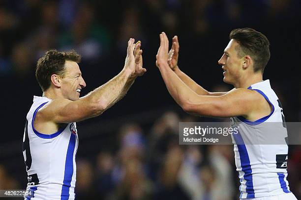 Brent Harvey of the Kangaroos celebrates a goal with Ben Jacobs during the round 18 AFL match between the Carlton Blues and the North Melbourne...