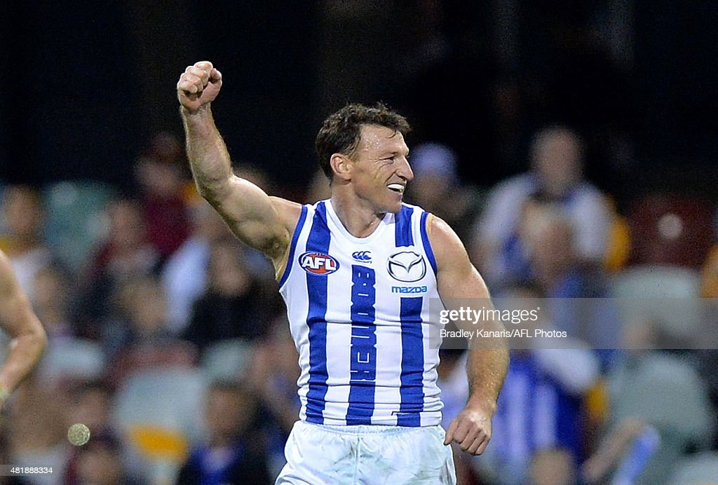 Brent Harvey of the Kangaroos celebrates after kicking a goal in his 400th AFL match during the round 17 AFL match between the Brisbane Lions and the...
