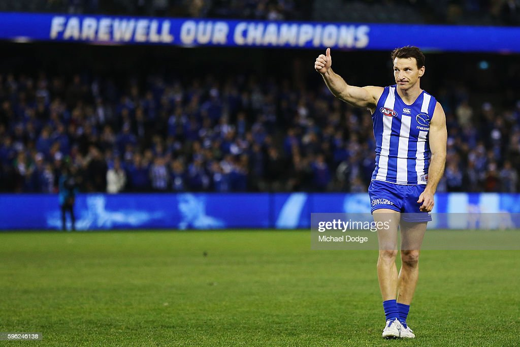 Brent Harvey of the Kangaroos delisted at the end of the season thanks the fans after defeat during the round 23 AFL match between the North...