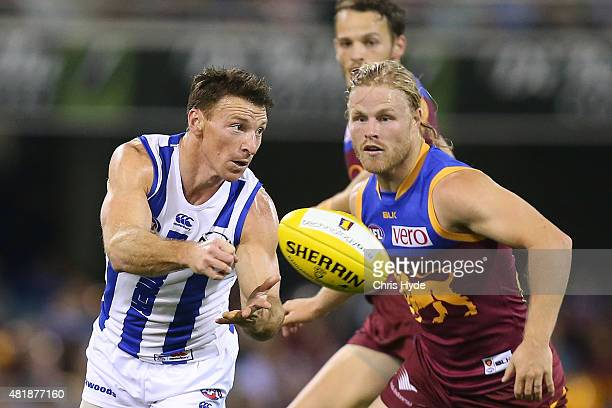 Brent Harvey of the Kangaroos handballs during the round 17 AFL match between the Brisbane Lions and the North Melbourne Kangaroos at The Gabba on...
