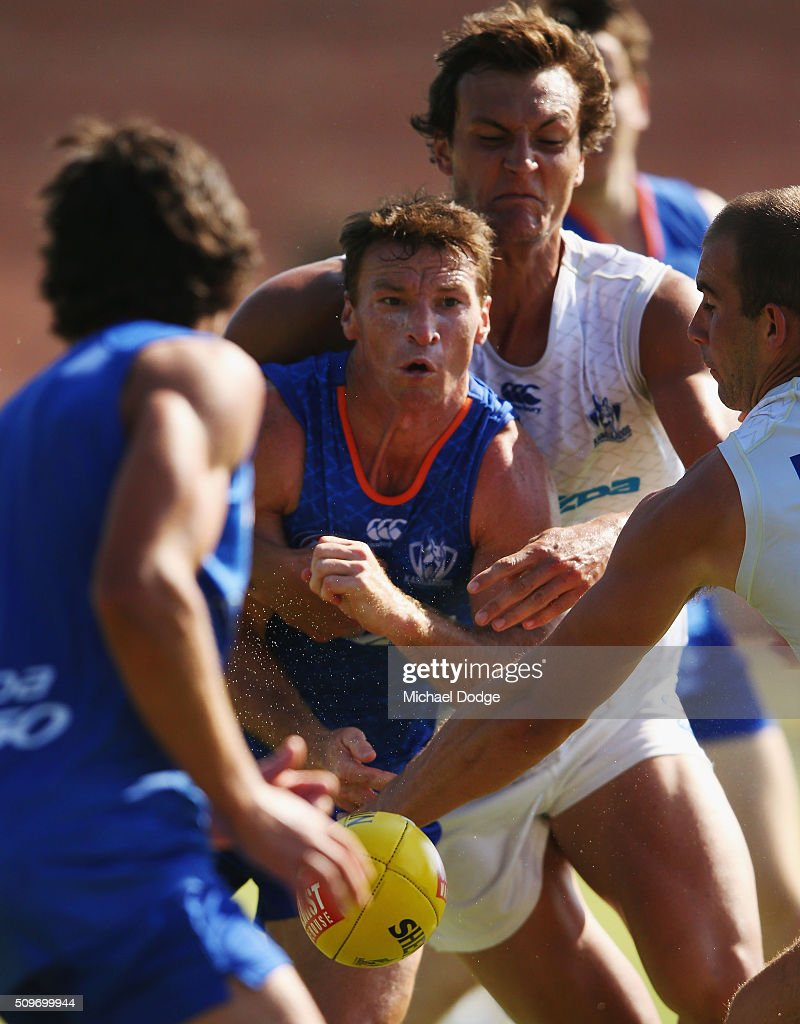 <a gi-track='captionPersonalityLinkClicked' href=/galleries/search?phrase=Brent+Harvey&family=editorial&specificpeople=214661 ng-click='$event.stopPropagation()'>Brent Harvey</a> of the Kangaroos handballs while getting tackled during the North Melbourne AFL Intra-Club match at Arden Street Ground on February 12, 2016 in Melbourne, Australia.