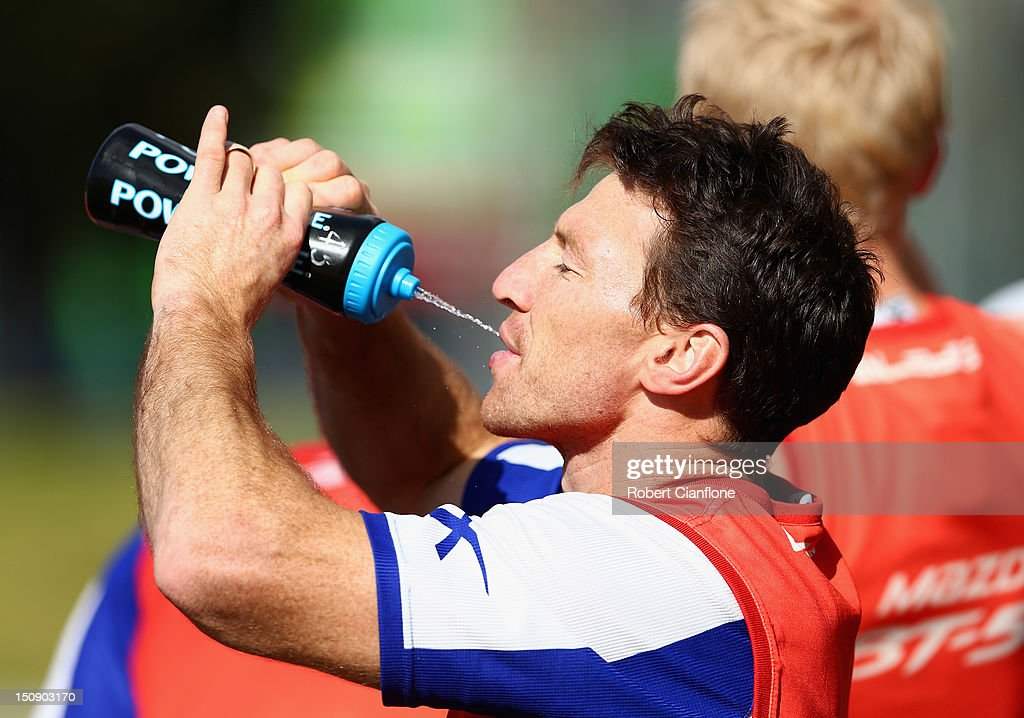 <a gi-track='captionPersonalityLinkClicked' href=/galleries/search?phrase=Brent+Harvey&family=editorial&specificpeople=214661 ng-click='$event.stopPropagation()'>Brent Harvey</a> of the Kangaroos has a drink during a training session at Aegis Park on August 29, 2012 in Melbourne, Australia.