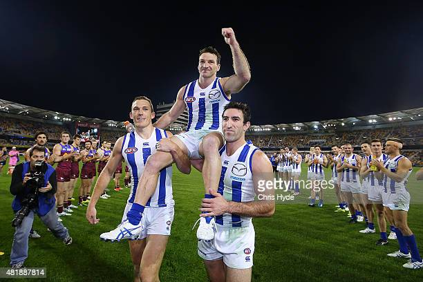Brent Harvey of the Kangaroos is chaired from the field after his 400th game during the round 17 AFL match between the Brisbane Lions and the North...