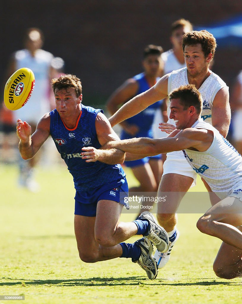 <a gi-track='captionPersonalityLinkClicked' href=/galleries/search?phrase=Brent+Harvey&family=editorial&specificpeople=214661 ng-click='$event.stopPropagation()'>Brent Harvey</a> of the Kangaroos is tackled by Shaun Atley of the Kangaroos during the North Melbourne AFL Intra-Club match at Arden Street Ground on February 12, 2016 in Melbourne, Australia.