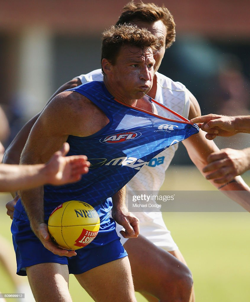 <a gi-track='captionPersonalityLinkClicked' href=/galleries/search?phrase=Brent+Harvey&family=editorial&specificpeople=214661 ng-click='$event.stopPropagation()'>Brent Harvey</a> of the Kangaroos is tackled during the North Melbourne AFL Intra-Club match at Arden Street Ground on February 12, 2016 in Melbourne, Australia.