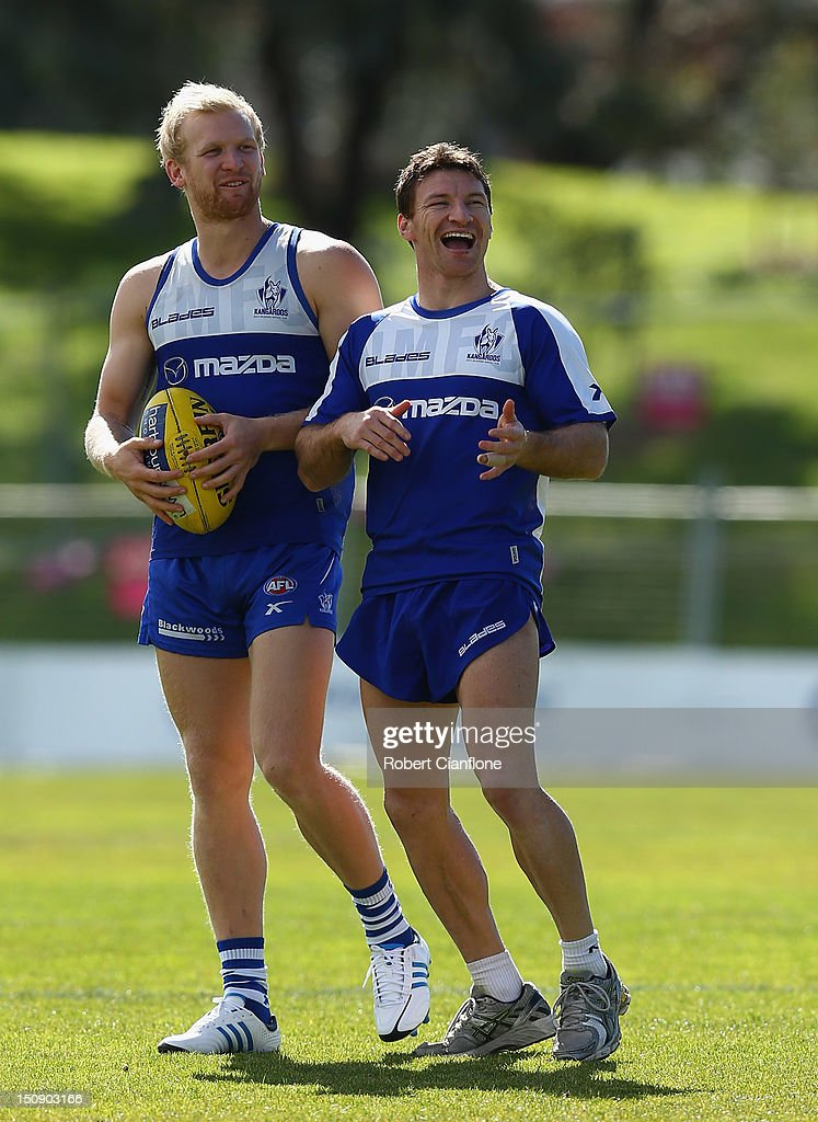 <a gi-track='captionPersonalityLinkClicked' href=/galleries/search?phrase=Brent+Harvey&family=editorial&specificpeople=214661 ng-click='$event.stopPropagation()'>Brent Harvey</a> of the Kangaroos laughs during a training session at Aegis Park on August 29, 2012 in Melbourne, Australia.