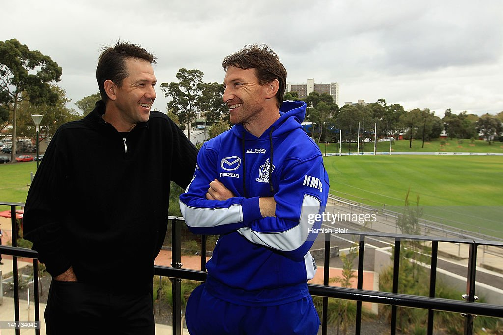 Brent Harvey (R) of the Kangaroos laughs with Australian cricket player Ricky Ponting after a press conference at Aegis Park on March 23, 2012 in Melbourne, Australia.