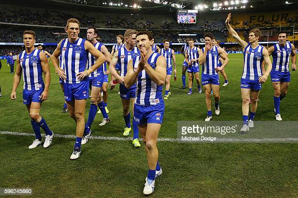 Brent Harvey of the Kangaroos leads the team off after defeat during the round 23 AFL match between the North Melbourne Kangaroos and the Greater...