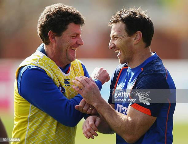 Brent Harvey of the Kangaroos not to be recontracted for next season by the club reacts with assistant coach Leigh Tudor during a North Melbourne...