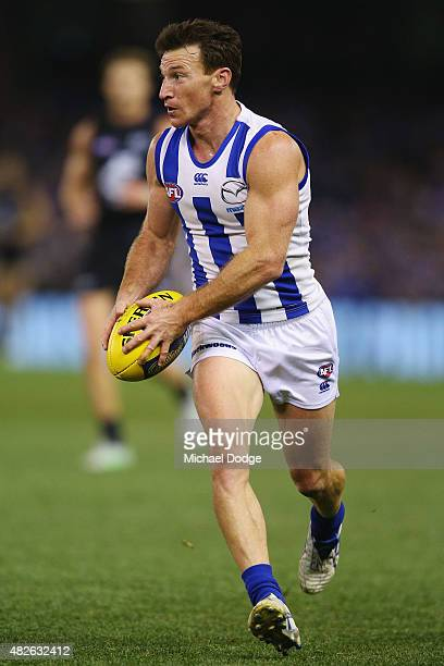 Brent Harvey of the Kangaroos runs with the ball during the round 18 AFL match between the Carlton Blues and the North Melbourne Kangaroos at Etihad...