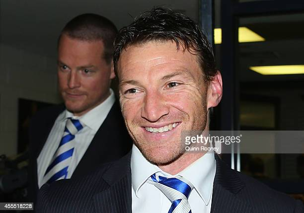 Brent Harvey of the Kangaroos smiles as he leaves the tribunal after the AFL judiciary hearing at AFL House on September 16 2014 in Melbourne...