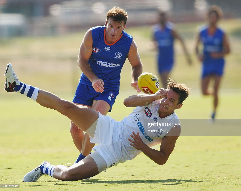 <a gi-track='captionPersonalityLinkClicked' href=/galleries/search?phrase=Brent+Harvey&family=editorial&specificpeople=214661 ng-click='$event.stopPropagation()'>Brent Harvey</a> of the Kangaroos tackles Mitchell Hibberd during the North Melbourne AFL Intra-Club match at Arden Street Ground on February 12, 2016 in Melbourne, Australia.
