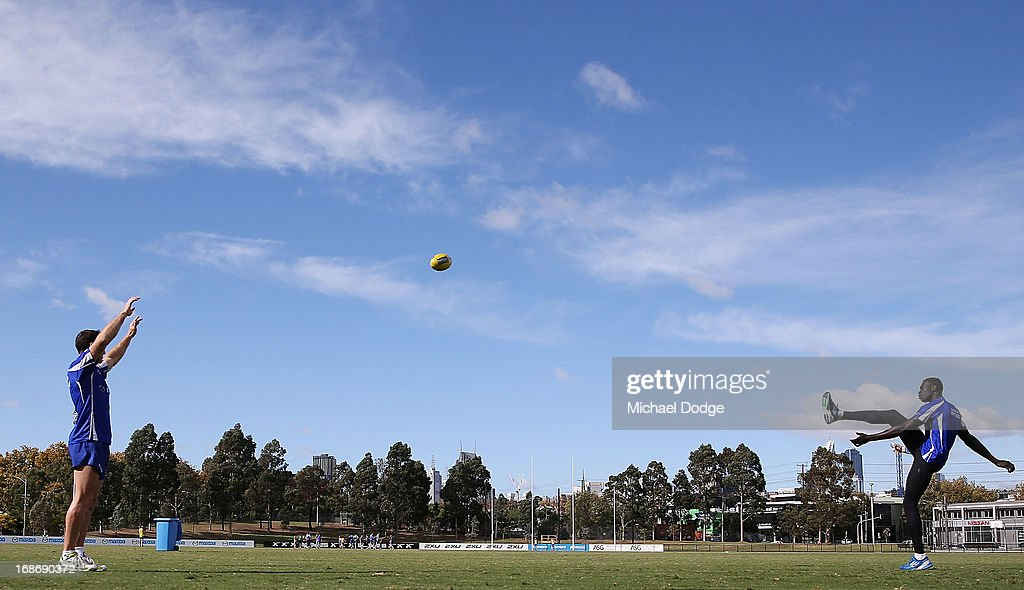 <a gi-track='captionPersonalityLinkClicked' href=/galleries/search?phrase=Brent+Harvey&family=editorial&specificpeople=214661 ng-click='$event.stopPropagation()'>Brent Harvey</a> (L) watches Majak Daw kick for goal during a North Melbourne Kangaroos AFL training session at Aegis Park on May 14, 2013 in Melbourne, Australia.
