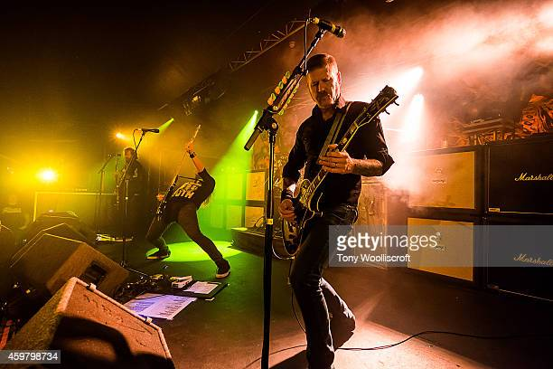 Brent Hinds and Troy Sanders and Bill Kelliher of Mastodon performs at Rock City on December 1 2014 in Nottingham England