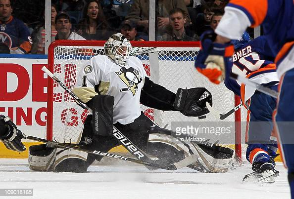 Brent Johnson of the Pittsburgh Penguins surrenders a first period goal to Michael Grabner of the New York Islanders on February 11 2011 at Nassau...