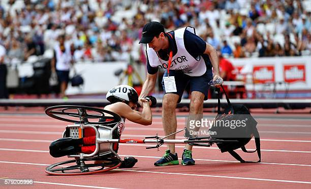 Brent Lakatos of Canada is helped up following a crash in the Men's T54 1500m during Day Two of the Muller Anniversary Games at The Stadium Queen...