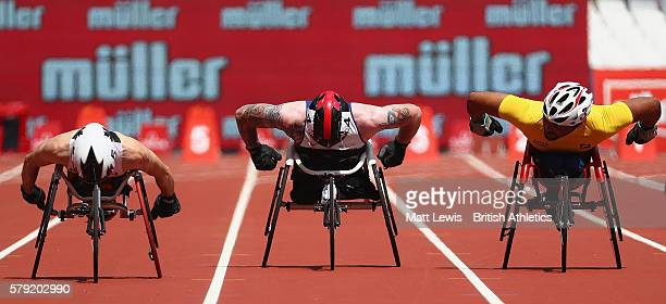 Brent Lakatos of Canada Mickey Bushell of Great Britain and Ariosvaldo Fernandes Silva of Brazil in action during the Mens 100m T53 race during day...