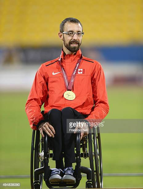 Brent Lakatos of Canada poses with his gold medal for the men's 800m T53 final during the Evening Session on Day Eight of the IPC Athletics World...