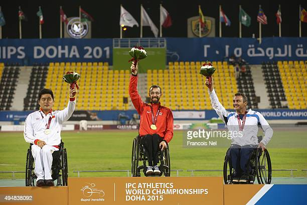Brent Lakatos of Canada poses with his gold medal Huzhao Li of China silver and Pierre Fairbank of France bronze for the men's 800m T53 final during...