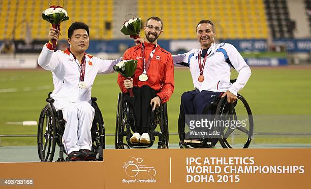Brent Lakatos of Canada poses with the gold Li Huzhao of China the silver and Pierre Fairbank of France the bronze during the Evening Session on Day...