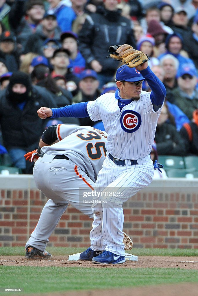 <a gi-track='captionPersonalityLinkClicked' href=/galleries/search?phrase=Brent+Lillibridge&family=editorial&specificpeople=4164757 ng-click='$event.stopPropagation()'>Brent Lillibridge</a> #20 of the Chicago Cubs forces out <a gi-track='captionPersonalityLinkClicked' href=/galleries/search?phrase=Brandon+Crawford&family=editorial&specificpeople=5580312 ng-click='$event.stopPropagation()'>Brandon Crawford</a> #35 of the San Francisco Giants at third base during the seventh inning on April 13, 2013 at Wrigley Field in Chicago, Illinois.