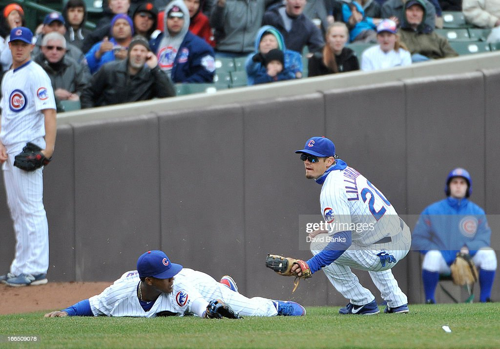<a gi-track='captionPersonalityLinkClicked' href=/galleries/search?phrase=Brent+Lillibridge&family=editorial&specificpeople=4164757 ng-click='$event.stopPropagation()'>Brent Lillibridge</a> #20 of the Chicago Cubs makes a catch as <a gi-track='captionPersonalityLinkClicked' href=/galleries/search?phrase=Starlin+Castro&family=editorial&specificpeople=5970945 ng-click='$event.stopPropagation()'>Starlin Castro</a> #13 gets out of the way during the sixth inning against the San Francisco Giants on April 13, 2013 at Wrigley Field in Chicago, Illinois.